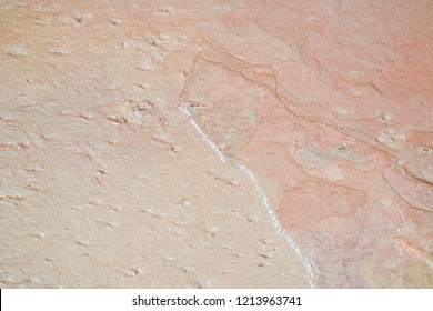 Close up of a pinkish stone suface.