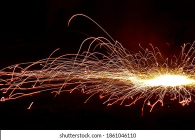 Close up of a pinwheel firework ('chakra') spinning on the ground during the festival of Diwali in India