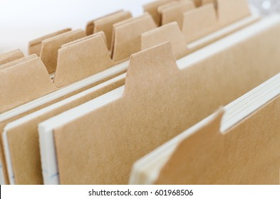 Close up of plain brown index card system dividers, left blank to provide copy space.