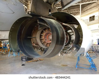 Close up of plane engine in a hangar, maintenance work and fixing, industry concept