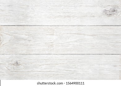 Close up plank, wood, wall, table, floor, background with slightly weathered white painted texture.