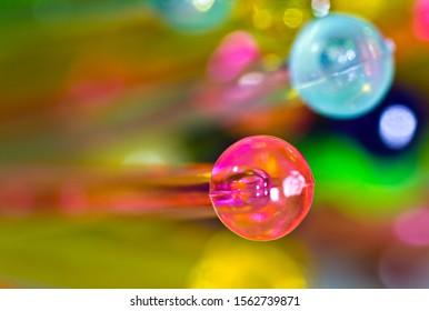 close up of plastic colorful drink stirrer