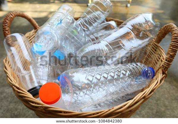 Close up plastic garbage bottles in bamboo basket recycle concept