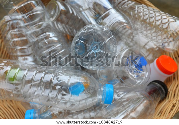 Close up plastic garbage bottles in bamboo basket recycle concept, top view