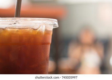 Close up of plastic take away glass of iced black coffee (Americano)