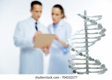 Close up of plastic three dimensional model of dna