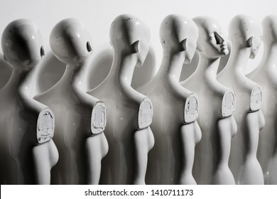 Close Up of Plastic Woman Mannequins Standing in The Line, With One Looking to Another Direction then the Others