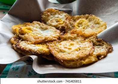 Close up of a plate full of fried eggs at a small warung in Java, Indonesia, 2017