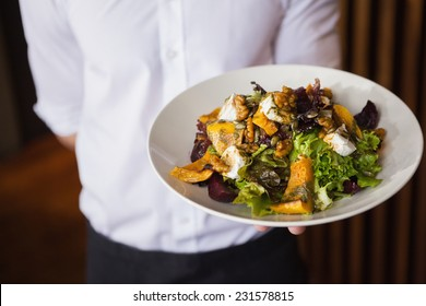 Close up of plate of salad in a bar