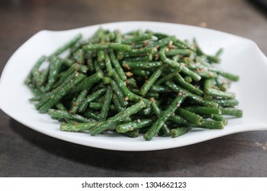 Close up of a plate of stir fried long beans
