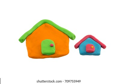 close up play dough two houses isolated on white background. play dough house for children creative education concept. kid playing.