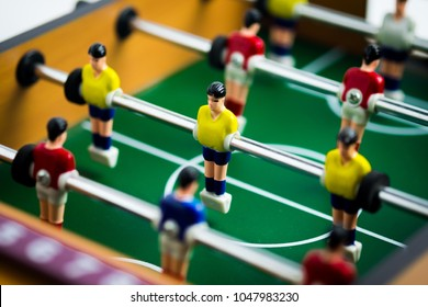 Close up of player on mini football game on table, The concept of fighting in business, vignette filter effect and selective focus.