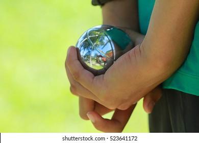 close up of player's hand at sport playing the french game petanque