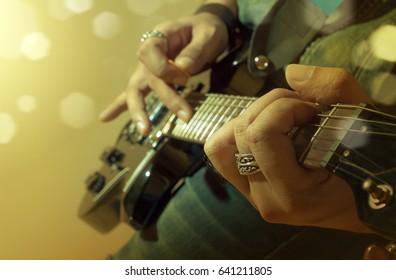 close up playing electric guitar on the stage concert