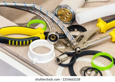 Close up of Plumbing Tools and Sink Drain Parts