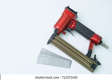 Close up pneumatic nailer gun on white background.