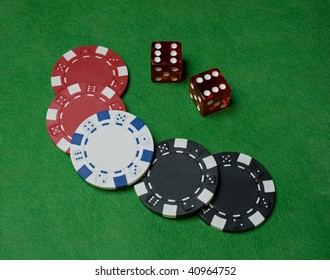 Close up of poker chips and two dice
