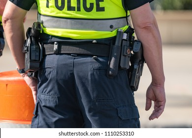 Close up of police belt and gun with a shallow depth of field and copy space