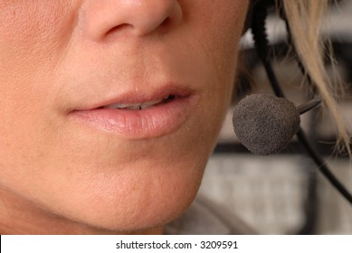 A close up of a police dispatcher's mouth