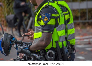 Close Of Police Men With Bicycles At Amsterdam The Netherlands 2018