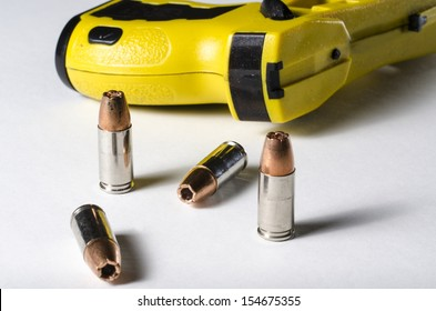 a close up of a police stun gun and bullets.