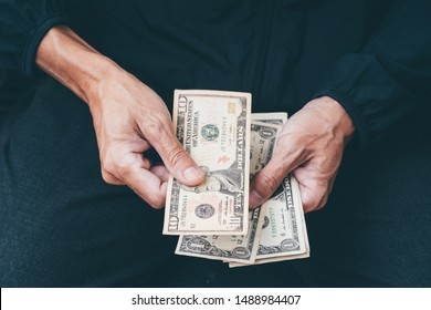 Close up of poor man hand with small money