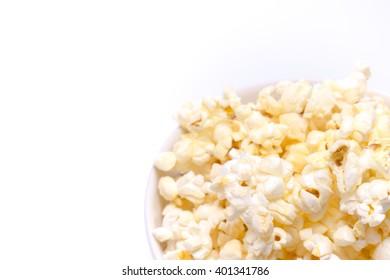 Close up of popcorn on white background
