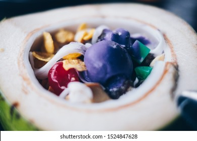 """Close up of the popular and favorite Filipino cold dessert """"Buko"""" or Coconut Halo-halo (also spelled haluhalo). Selective focus."""