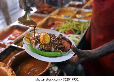 Close up the popular Nasi Kandar or Kandar Rice in Penang State, Malaysia