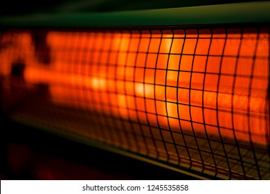 Close up of portable electric halogen heater on black background