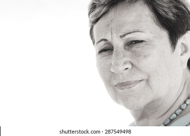 Close up portait of happy senior woman on the beach
