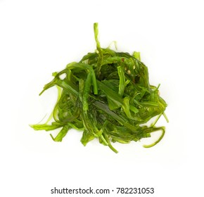 Close up portion of green wakame seaweed salad isolated on white background, elevated top view, directly above