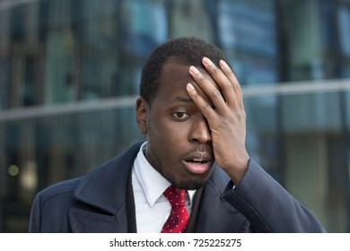 Close up portrait of african american businessman with face palm gesture. Disappointed stressed out black business man making facepalm with hand.