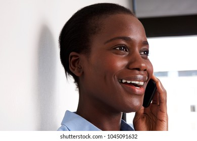 Close up portrait of african american lady talking on cell phone and smiling