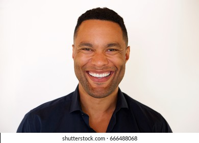 Close up portrait of african american young man smiling against white background