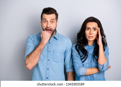 Close up portrait amazed two people she her he him his couple lady guy look oh no facial expression unbelievable unexpected news wear casual jeans denim shirts outfit clothes isolated grey background