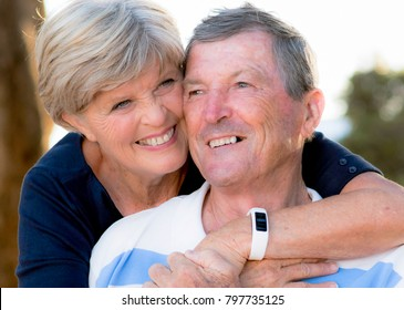 close up portrait of American senior beautiful and happy mature couple around 70 years old showing love and affection smiling together in the park having a romantic walk relaxed enjoying retirement