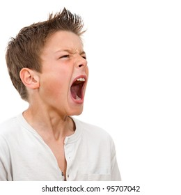 Close up portrait of angry boy shouting. Isolated on white background