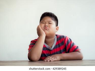 Close up portrait of Asian boy, Bored action.