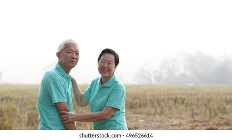 Close up portrait of Asian senior couple on bright green background