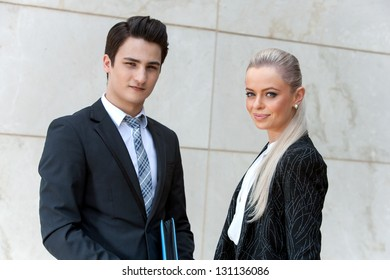 Close up portrait of attractive business partners looking at camera.