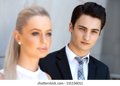 Close up portrait of attractive businessman with female partner.