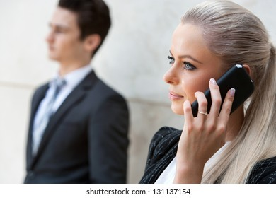 Close up portrait of attractive businesswoman talking on smart phone.