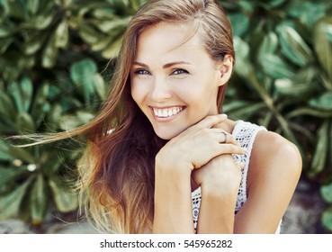 Close up portrait of attractive caucasian smiling woman