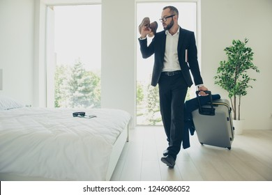 Close up portrait of attractive handsome in formalwear and specs his him he finally get packed going away from bedroom hurry up to airport