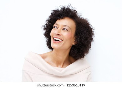 Close up portrait of attractive middle age african american woman laughing against white background
