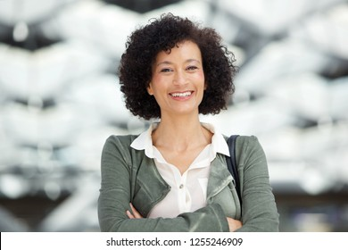 Close up portrait of attractive middle age african american woman smiling
