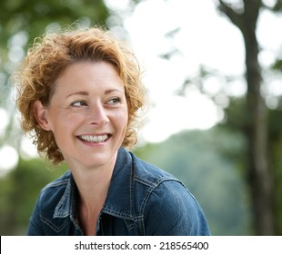 Close up portrait of an attractive older woman smiling and looking away