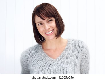 Close up portrait of an attractive older woman smiling against white background