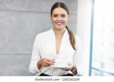 Close up portrait of attractive smiling businesswoman at workplace